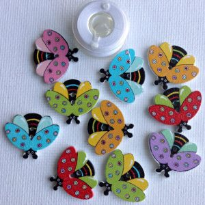 1053-wooden-ladybug-open-wings-buttons